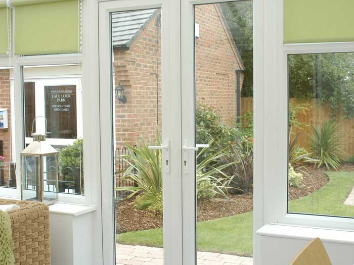 Double doors leading out from the conservatory