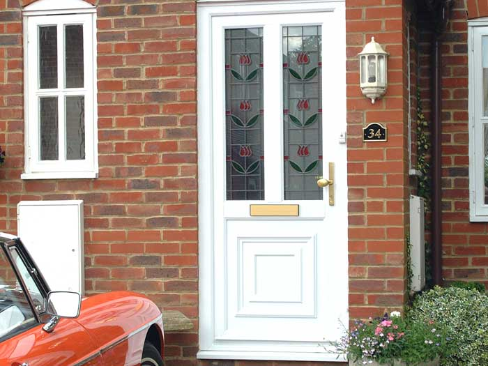 White front door with two decorative glass panels