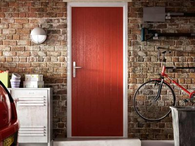 A red fire door lading out into the garage