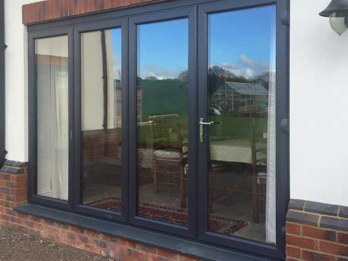 A folding New Wave door in black aluminium