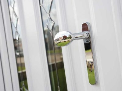 uPVC entrance door with chrome hardware
