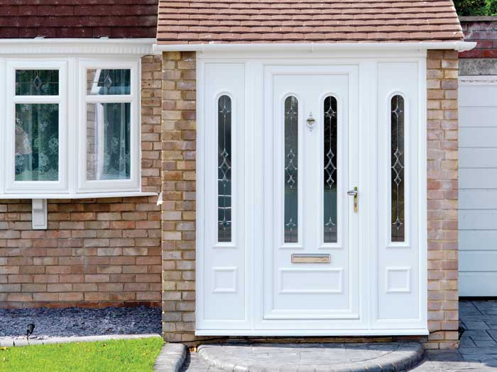 white entrance door with side panels