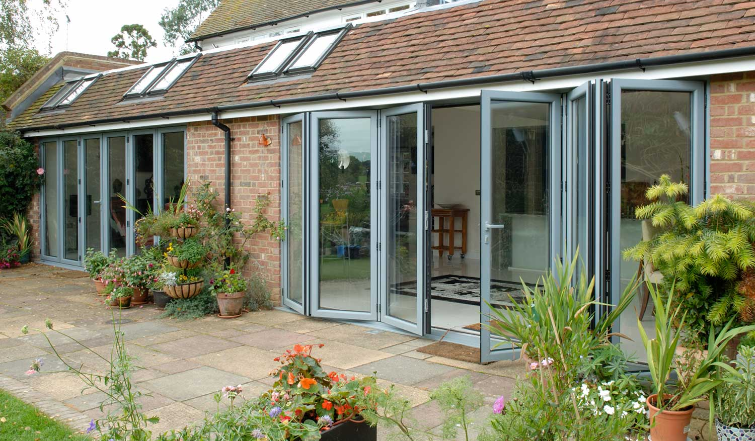 Upvc folding doors in wiltshire oxfordshire emerald for Upvc folding doors