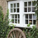 Vertical sliding sash windows in white uPVC