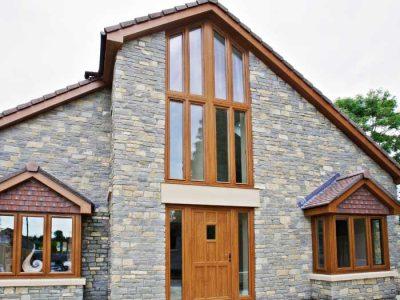 Angled uPVC windows in oak colour