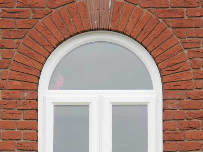 Arched uPVC white window