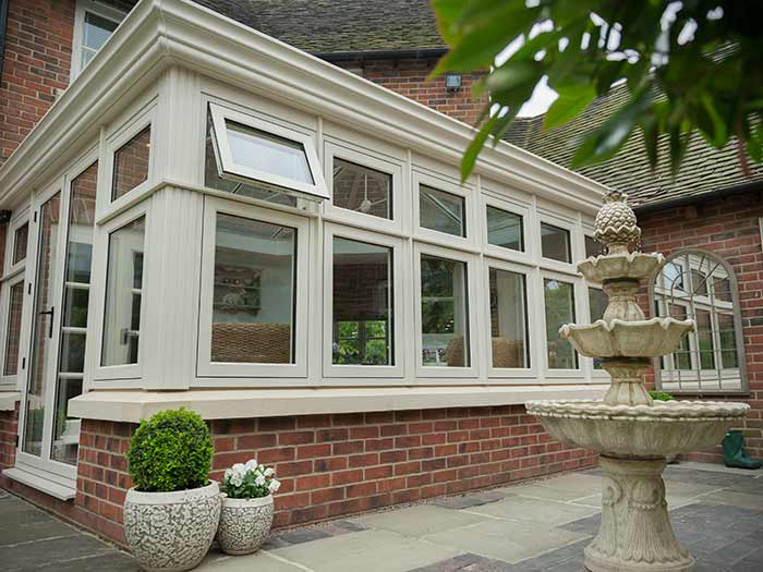 White orangery style conservatory with brick base