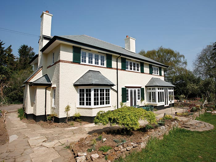 White aluminium windows for large white property