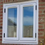 White 19th century style traditional windows made using uPVC