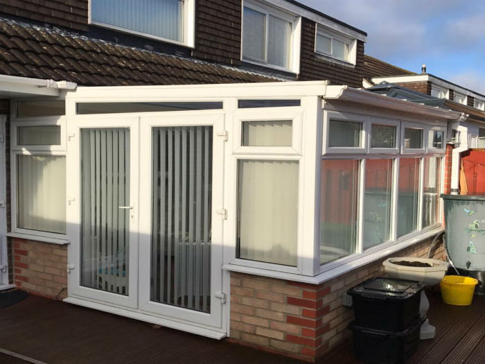 White upvc conservatory installation with doors