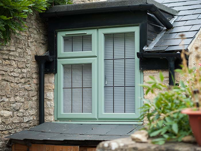 Chartwell green uPVC window with traditional lead detail