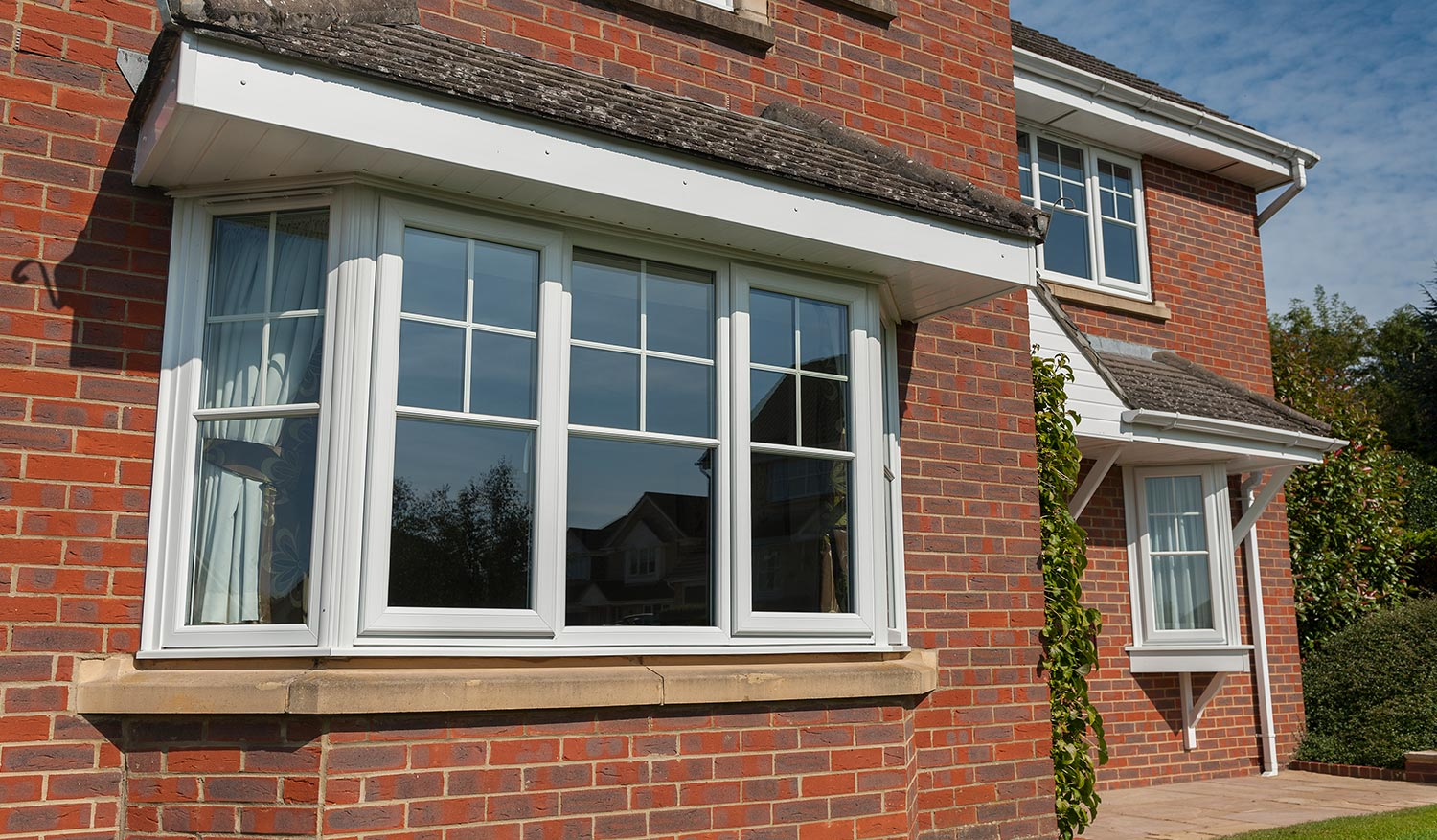 Heritage uPVC window in white with georgian bars