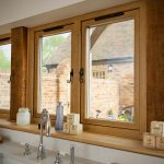 Oak effect residence 9 windows with a view out from kitchen onto the garden