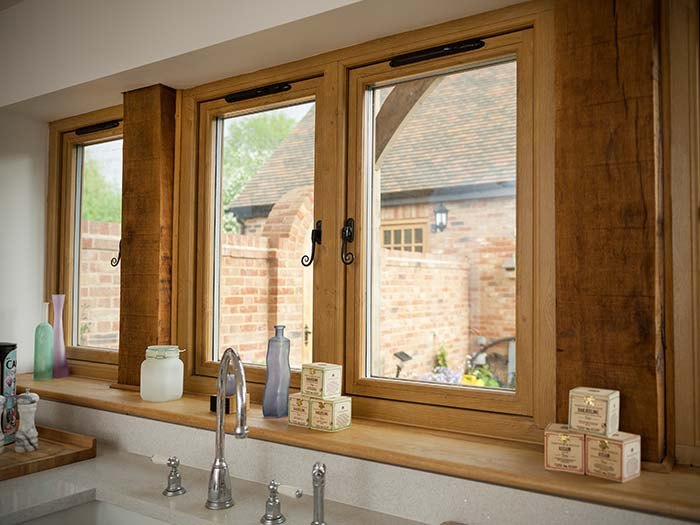 Oak effect windows with a view out from kitchen onto the garden