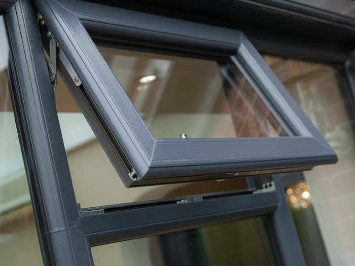 uPVC windows in grey woodgrain finish