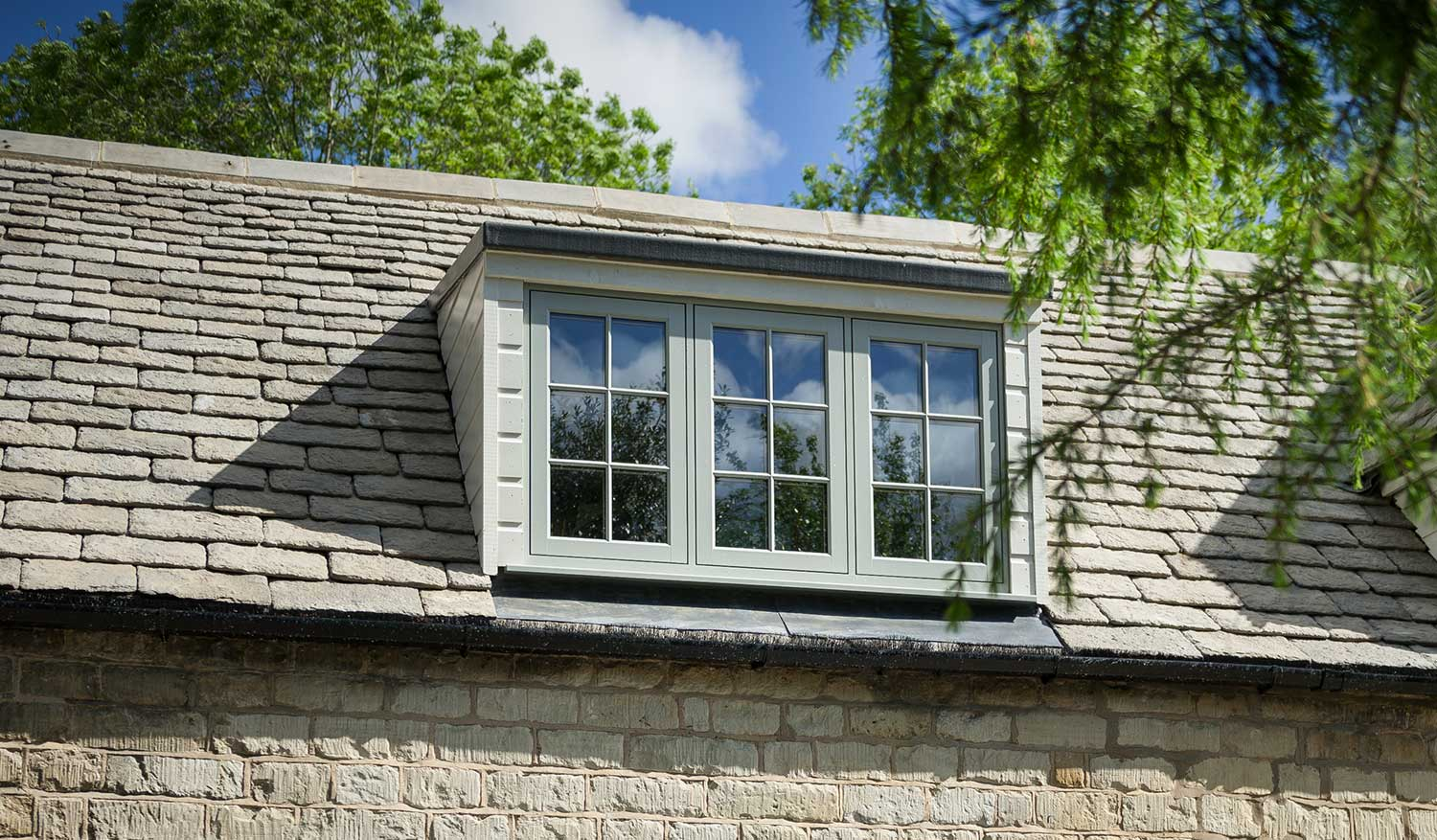 Flush sash timber effect window in chartwell green