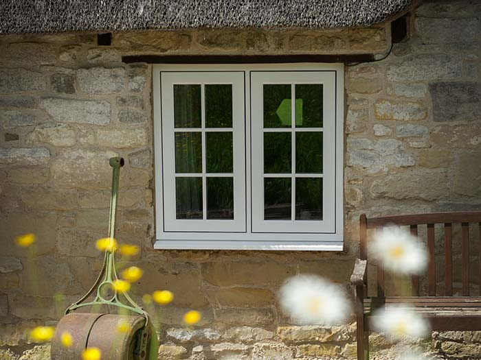 White traditional style windows for period cottage