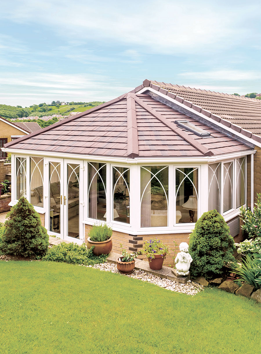 bespoke orangery with decorative features and tiled roof