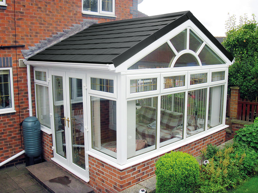 white upvc orangery with brickwork