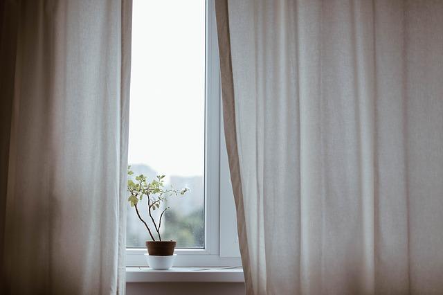 Cream curtains and white window