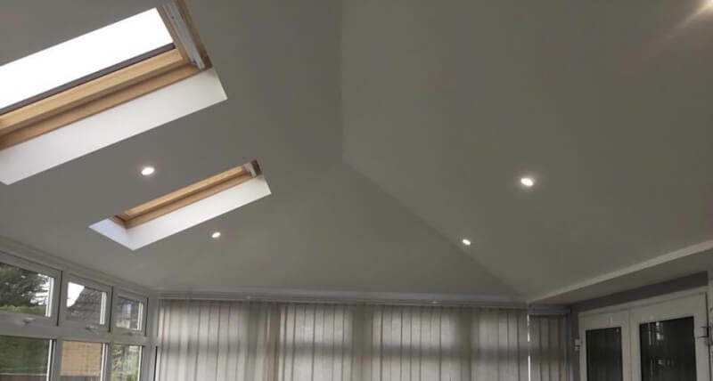 white roof extension with skylights